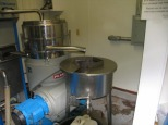 Olive oil releases from the centrifuge. By Wayne Sherman.