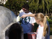 Student volunteers touching up the demonstration horno behind the padre's quarters. Photo by Michael H. Imwalle