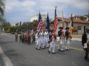 Procession down Canon Perdido Street during Flag Day. Photo by Roger Knox.