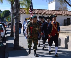 Los Soldados, followed by the Oxnard High School Air Force JROTC march toward the parade ground. Photo by Michael H. Imwalle.