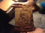 Image of Saint Barbara pressed into wet clay. Photo courtesy of Armando de la Rocha.