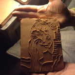 Image of Saint Barbara pressed into wet clay. Photo courtesy of Armando de la Rocha.