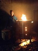 Armando firing the tiles in the kiln at his studio. Photo courtesy of Armando de la Rocha.
