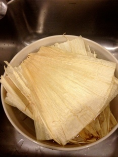 I would push the corn husks downward into the bowl every so often since they tended to float up, leaving the top husks partially out of the water. Photo by Brittany Avila.