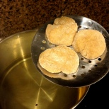 I was able to fit three balls at a time onto the spoon to speed up the frying process. Photo by Brittany Avila.