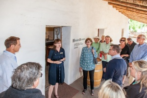 Dr. Anne Petersen beginning her tour of Casa de la Guerra. Photo by Frtiz Olenberger.
