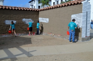Whitewashing the Presidio defense wall.  Photo by Brittany Sundberg.
