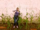 Lottie with corn above her head.
