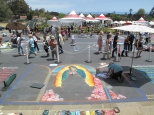 Featured Artist Blair Looker working on her 12' x 16' street painting, Virgin of Guadalupe. Photo by Melissa Chatfield.