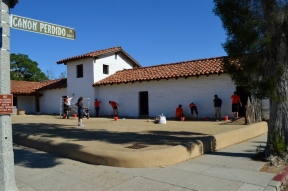 Volunteers whitewash the walls of the Presidio Northeast Corner. Photo by Mike Imwalle.