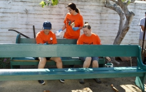 Volunteers paint benches from Casa de la Guerra. Photo by MIke Imwalle.