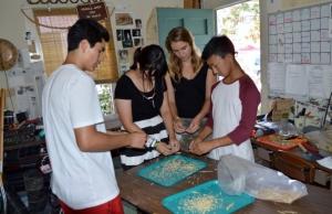 Piero, Pica, Lauren, and Weston threshing White Sonora Wheat. Photo by Mike Imwalle.