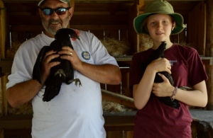 Mike and Ann holding Belle and Westina. Photo by Brittany Sundberg.