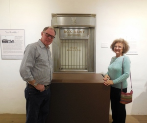 Doug Campbell and Mary Louise Days with a historic service window from the Santa Barbara Downtown Post Office.