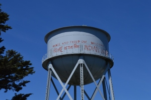 "Political Statements painted on the Water Tank recently ""Restored"" to commemorate the occupation of the Island by the Indians of All Tribes. Photo by Mike Imwalle."
