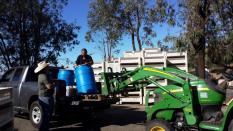 "Tom Walton picking up 120.9 gallons of ""Liquid Sunshine"" from Figueroa Farms. Photo by Leanne Haslouer."