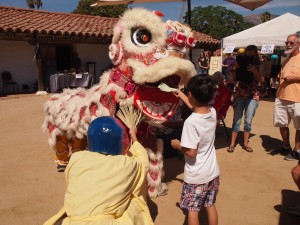 Lion dancers at the Asian American Neighborhood Festival. Photo by Dr. Paul Mori.